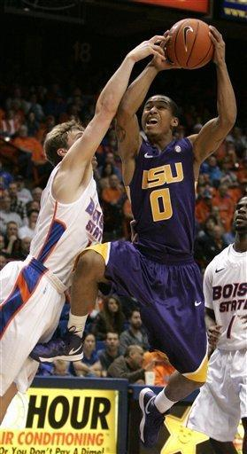 LSU's Charles Carmouche (0) puts a shot past the reach of Boise State's Jeff Elorriaga (11) during the first half of an NCAA college basketball game on Friday, Dec. 14, 2012 in Boise, Idaho. (AP Photo/Matt Cilley)