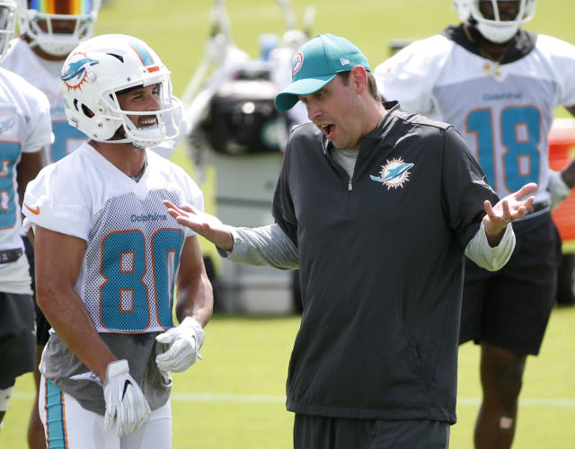 """""""One of the boys"""": Dolphins receiver Danny Amendola, left, describes head coach Adam Gase as the opposite of New England head coach Bill Belichick. (AP)"""