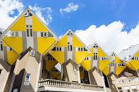 <p>As if the geometric architecture wasn't enough, a lemon-yellow facade creates a striking home exterior.</p>