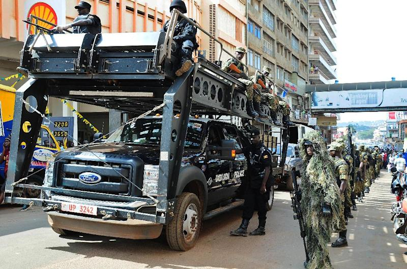 UPDF soldiers and police forces patrol streets in Kampala with a tactical operation vehicle on July 3 2014