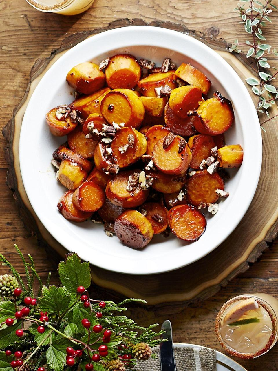 """<p>A sprinkle of candied or spiced pecans adds the perfect amount of crunch to these rich, syrupy sweet potatoes.</p><p><em><a href=""""https://www.goodhousekeeping.com/food-recipes/a16043/sorghum-sweet-potatoes-recipe-clx1114/"""" rel=""""nofollow noopener"""" target=""""_blank"""" data-ylk=""""slk:Get the recipe for Sorghum-Glazed Sweet Potatoes »"""" class=""""link rapid-noclick-resp"""">Get the recipe for Sorghum-Glazed Sweet Potatoes »</a></em></p><p><strong>RELATED: </strong><a href=""""https://www.goodhousekeeping.com/food-recipes/g657/sweet-potato-recipes/"""" rel=""""nofollow noopener"""" target=""""_blank"""" data-ylk=""""slk:40 Best Sweet Potato Recipes That Are Perfect for Any Fall Occasion"""" class=""""link rapid-noclick-resp"""">40 Best Sweet Potato Recipes That Are Perfect for Any Fall Occasion</a></p>"""