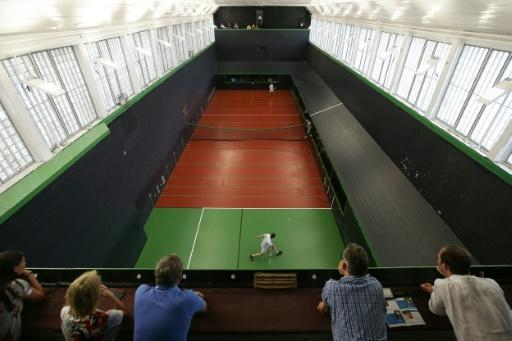 Nick Howell and Ben Taylor-Matthews (top) play a match at the Real Tennis Champions Trophy at Hampton Court Palace, south-west London, on July 20, 2018