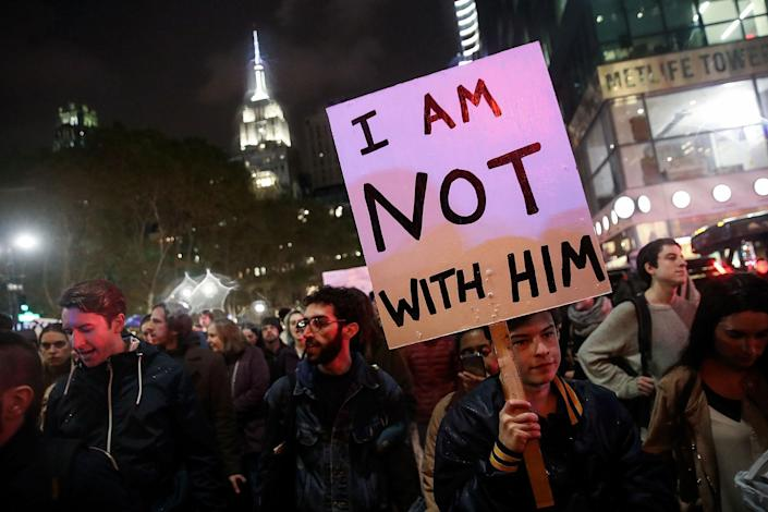 <p>Hundreds of anti-Donald Trump protestors march through the street on 6th Avenue on their way to Trump Tower, November 9, 2016 in New York City. Republican candidate Donald Trump won the 2016 presidential election in the early hours of the morning in a widely unforeseen upset. (Photo by Drew Angerer/Getty Images) </p>