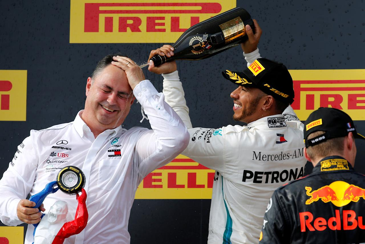 Formula One F1 - French Grand Prix - Circuit Paul Ricard, Le Castellet, France - June 24, 2018   Mercedes' Lewis Hamilton celebrates with team manager Ron Meadows after winning the race   REUTERS/Jean-Paul Pelissier