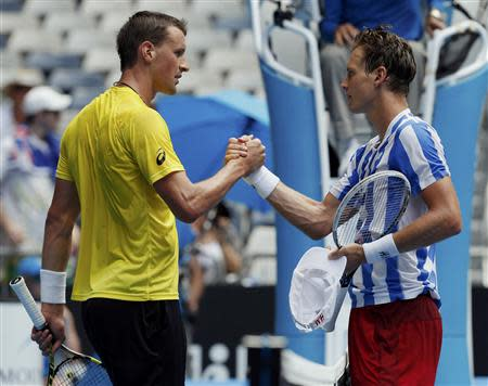 Tomas Berdych (R) of the Czech Republic shakes hands with Kenny De Schepper of France after winning their men's singles match at the Australian Open 2014 tennis tournament in Melbourne January 15, 2014. REUTERS/Bobby Yip