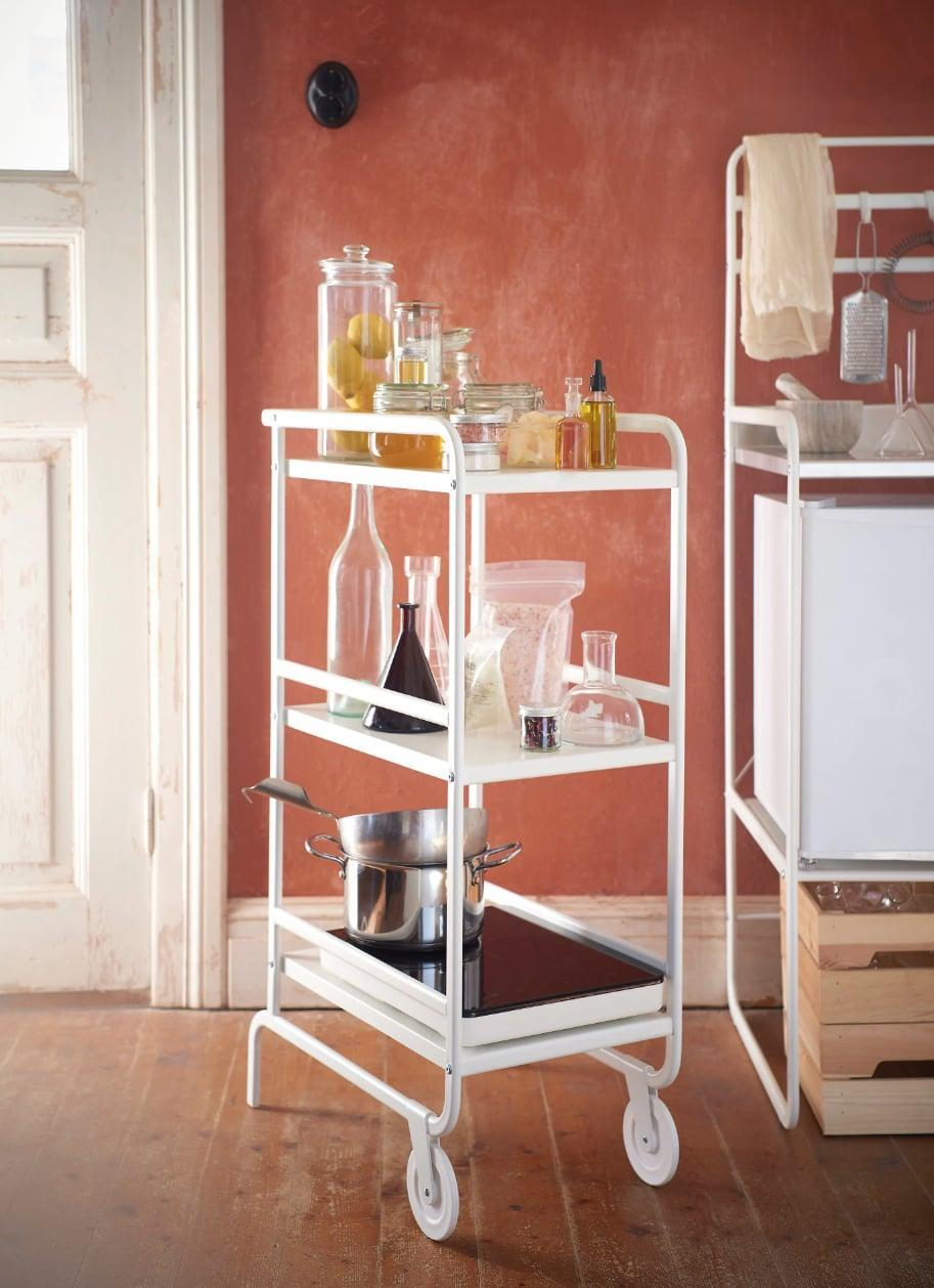 "<p>Slim and small, the <a href=""https://www.popsugar.com/buy/Sunnersta%20Utility%20Cart-446995?p_name=Sunnersta%20Utility%20Cart&retailer=ikea.com&price=30&evar1=casa%3Aus&evar9=46151613&evar98=https%3A%2F%2Fwww.popsugar.com%2Fhome%2Fphoto-gallery%2F46151613%2Fimage%2F46152184%2FSunnersta-Utility-Cart&list1=shopping%2Cikea%2Corganization%2Ckitchens%2Chome%20shopping&prop13=api&pdata=1"" rel=""nofollow noopener"" target=""_blank"" data-ylk=""slk:Sunnersta Utility Cart"" class=""link rapid-noclick-resp"">Sunnersta Utility Cart</a> ($30) fits in small nooks and crannies, and can be easily rolled out when needed.</p>"
