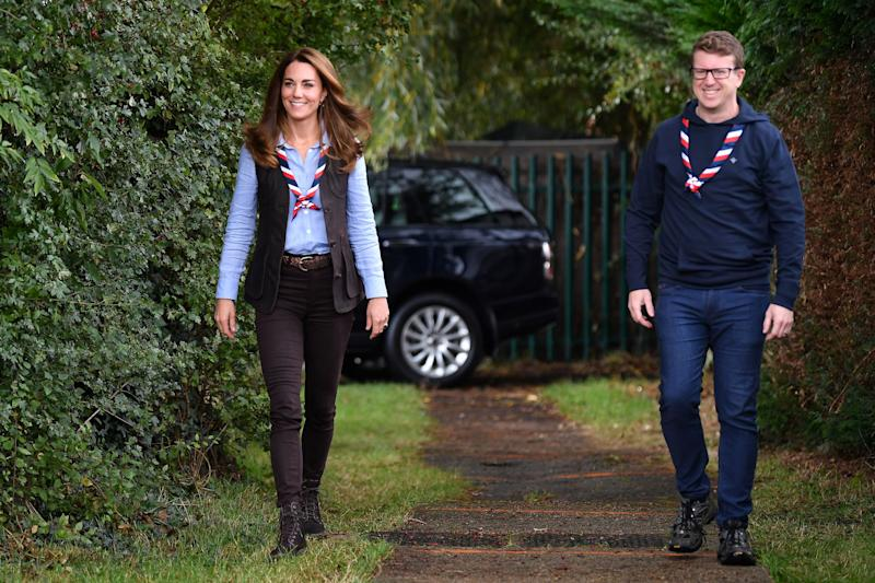 Britain's Catherine, Duchess of Cambridge (L) walks with Matt Hyde, Chief Executive of the Scouts, as she arrives to visit a Scout Group in Northolt, northwest London on September 29, 2020, where she joined Cub and Beaver Scouts in outdoor activities. - The Duchess learned how the Scouts have adapted during the COVID-19 pandemic, and continued Scouting sessions and online activities. (Photo by Daniel LEAL-OLIVAS / POOL / AFP) (Photo by DANIEL LEAL-OLIVAS/POOL/AFP via Getty Images)