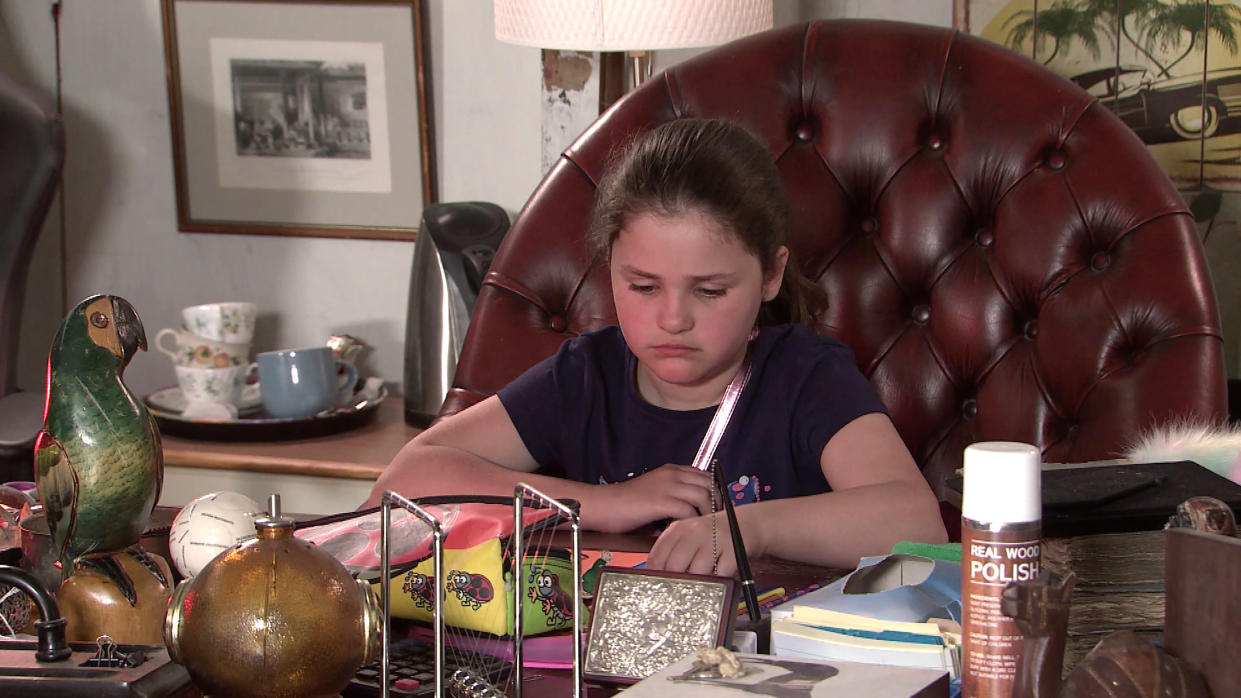 FROM ITV  STRICT EMBARGO - No Use Before Tuesday 20th July 2021  Coronation Street - Ep 10387  Monday 26th July 2021 - 2nd Ep  Hope Stape [ISABELLA FLANAGAN] works on her school project, but when she includes Phill in her picture, Tyrone Dobbs [ALAN HALSALL] becomes jealous and Fiz Stape [JENNIE McALPINE] is amused.  Picture contact David.crook@itv.com   This photograph is (C) ITV Plc and can only be reproduced for editorial purposes directly in connection with the programme or event mentioned above, or ITV plc. Once made available by ITV plc Picture Desk, this photograph can be reproduced once only up until the transmission [TX] date and no reproduction fee will be charged. Any subsequent usage may incur a fee. This photograph must not be manipulated [excluding basic cropping] in a manner which alters the visual appearance of the person photographed deemed detrimental or inappropriate by ITV plc Picture Desk. This photograph must not be syndicated to any other company, publication or website, or permanently archived, without the express written permission of ITV Picture Desk. Full Terms and conditions are available on  www.itv.com/presscentre/itvpictures/terms