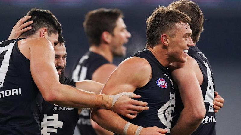 Carlton have beaten Essendon by one point in an AFL thriller at the MCG