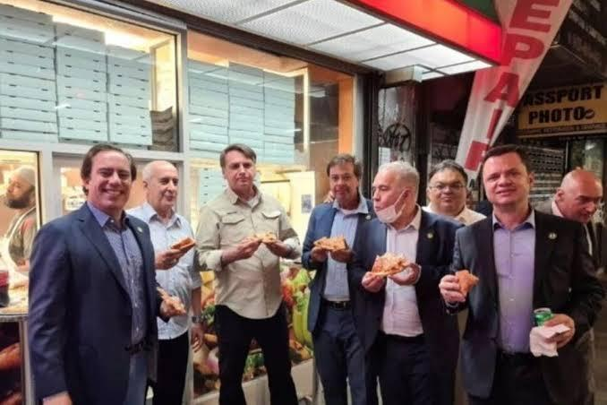 Unvaccinated Brazil President not allowed to dine indoors, eats pizza on the sidewalkin New York