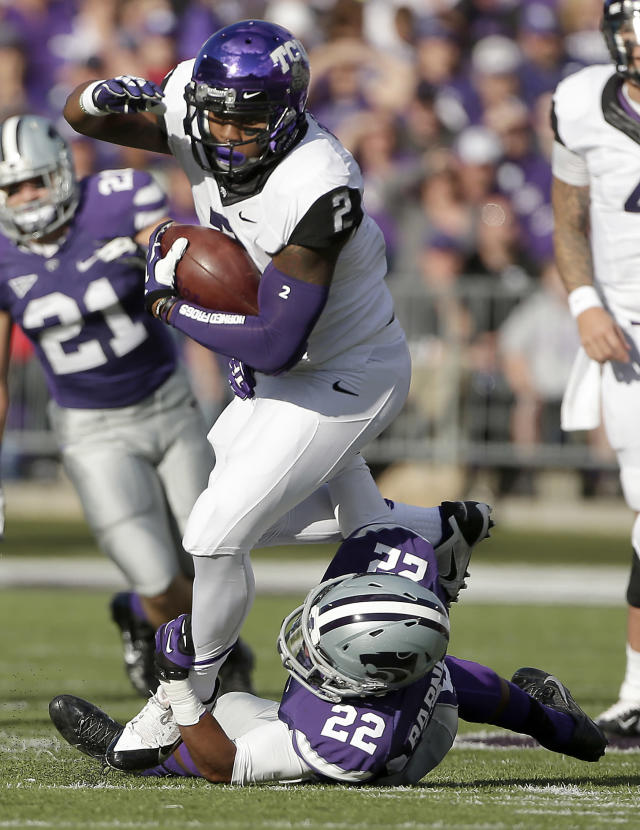 TCU quarterback Trevone Boykin (2) is tackled by Kansas State defensive back Dante Barnett (22) during the first half of an NCAA college football game Saturday, Nov. 16, 2013, in Manhattan, Kan. (AP Photo/Charlie Riedel)