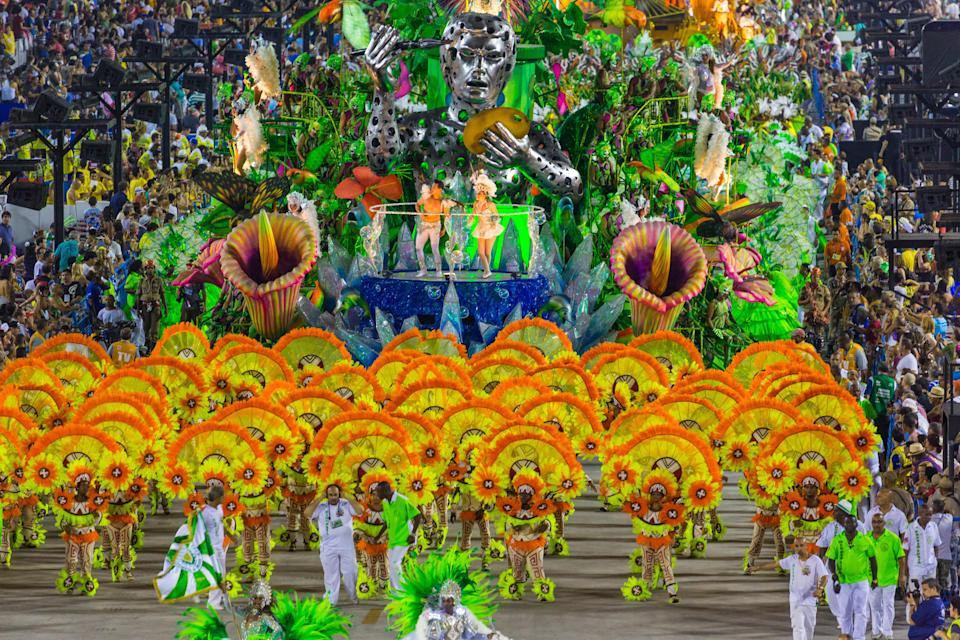 "<a href=""https://www.cntraveler.com/gallery/carnival-the-biggest-unruliest-and-classiest-parties-around-the-world?mbid=synd_yahoo_rss"" rel=""nofollow noopener"" target=""_blank"" data-ylk=""slk:Carnaval"" class=""link rapid-noclick-resp"">Carnaval</a> needs no introduction: The vibrant festival, with iterations all around the world, is an over-the-top celebration you have to see to believe. <a href=""https://www.cntraveler.com/story/when-rios-carnaval-returns-the-message-of-black-resistance-will-be-stronger-than-ever?mbid=synd_yahoo_rss"" rel=""nofollow noopener"" target=""_blank"" data-ylk=""slk:Carnaval in Rio"" class=""link rapid-noclick-resp"">Carnaval in Rio</a> is the largest of them all, meaning you'll have to compete with other travelers for tickets to February's famous Sambodrome parade, and the very best hotel and restaurants reservations. The reward? A week of samba dancing in the streets, elaborate costumes, and live music filling the city—basically, one enormous block party. Work with a connected travel specialist, and you can sign up to march alongside performers, in full costume, on the big night."