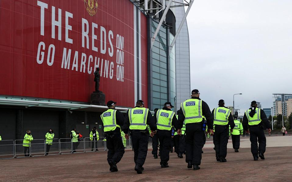 The police outside Old Trafford - Telegraph