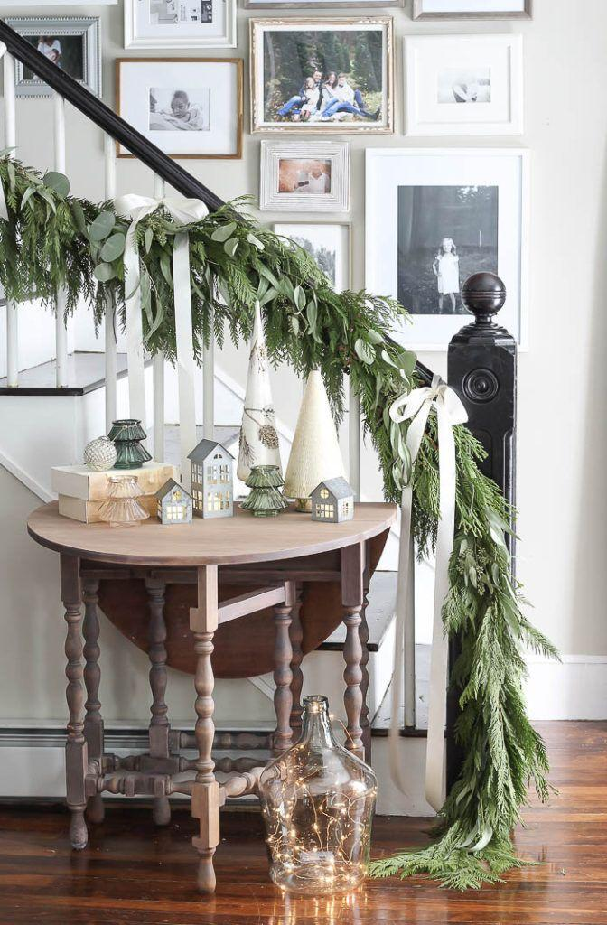 """<p>This lovely garland accented with simple bows that drape to the floor couldn't be easier to pull off. These bows are a neutral color, but you can use any shade that coordinates with your decor, too. </p><p><strong>See more at <a href=""""https://roomsforrentblog.com/2020/11/christmas-decor-favorites-2020/"""" rel=""""nofollow noopener"""" target=""""_blank"""" data-ylk=""""slk:Rooms for Rent"""" class=""""link rapid-noclick-resp"""">Rooms for Rent</a>.</strong></p><p><a class=""""link rapid-noclick-resp"""" href=""""https://www.amazon.com/Ribbli-Continuous-Bouquet-Wrapping-Arrangement/dp/B094N43LZ1/ref=sr_1_6_sspa?dchild=1&keywords=cream+ribbon&qid=1633171905&sr=8-6-spons&psc=1&spLa=ZW5jcnlwdGVkUXVhbGlmaWVyPUExVjNZTUUyQjYxMVRPJmVuY3J5cHRlZElkPUEwMzMyMDc5V0U2VVZHWVFIUFImZW5jcnlwdGVkQWRJZD1BMDQxNDI5MjNGVTcyN1pXQVhXODAmd2lkZ2V0TmFtZT1zcF9hdGYmYWN0aW9uPWNsaWNrUmVkaXJlY3QmZG9Ob3RMb2dDbGljaz10cnVl&tag=syn-yahoo-20&ascsubtag=%5Bartid%7C2164.g.37723896%5Bsrc%7Cyahoo-us"""" rel=""""nofollow noopener"""" target=""""_blank"""" data-ylk=""""slk:SHOP CREAM RIBBON"""">SHOP CREAM RIBBON</a></p>"""