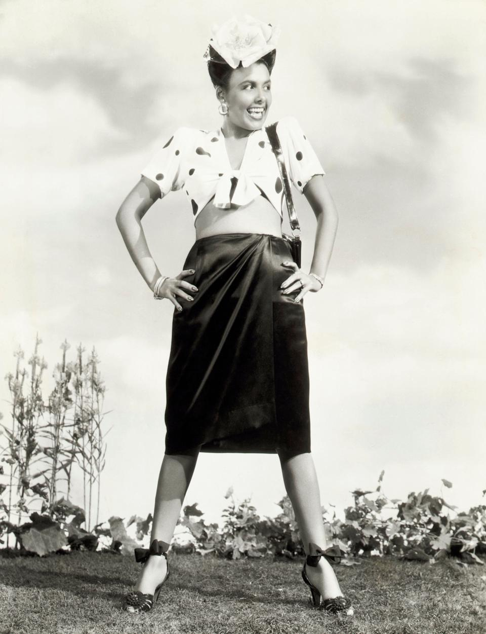 Lena Horne wears a printed top and black skirt in this photo, circa 1942.