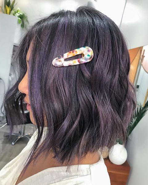 "<p>Just because you want to try lavender hair doesn't mean you need to go for something super bright. <strong>Have your colorist blend a few </strong><strong>dark-lavender <a href=""https://www.cosmopolitan.com/style-beauty/beauty/a30553400/hair-lowlights/"" rel=""nofollow noopener"" target=""_blank"" data-ylk=""slk:highlights"" class=""link rapid-noclick-resp"">highlights</a> with a chocolate-brown base</strong> for this muted, smokey finish.</p><p><a href=""https://www.instagram.com/p/CBzIVX7DvHg/"" rel=""nofollow noopener"" target=""_blank"" data-ylk=""slk:See the original post on Instagram"" class=""link rapid-noclick-resp"">See the original post on Instagram</a></p>"