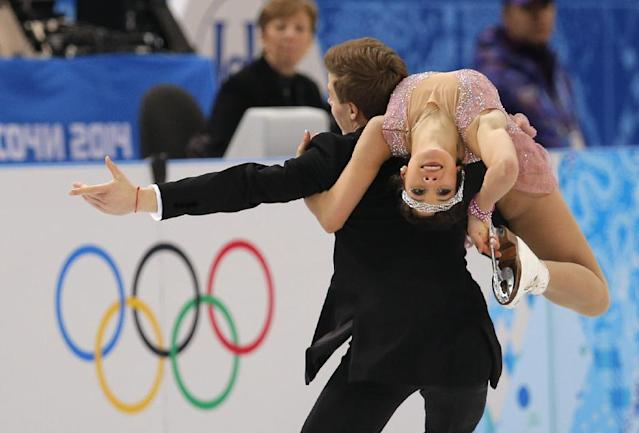 Elena Ilinykh and Nikita Katsalapov of Russia compete in the ice dance short dance figure skating competition at the Iceberg Skating Palace during the 2014 Winter Olympics, Sunday, Feb. 16, 2014, in Sochi, Russia. (AP Photo/Vadim Ghirda)