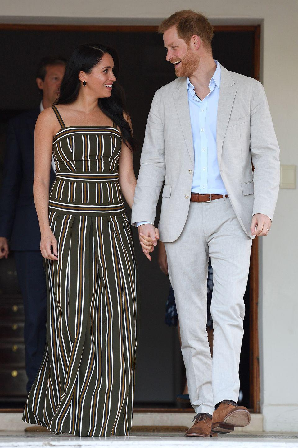 <p>The couple exchanges a quick glance at the Residence of the British High Commissioner during the royal tour of South Africa.</p>