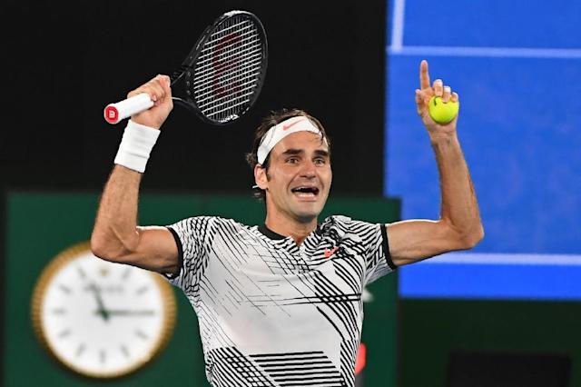 Switzerland's Roger Federer celebrates his victory against Spain's Rafael Nadal in the Australian Open men's singles final in Melbourne on January 29, 2017 (AFP Photo/William WEST)