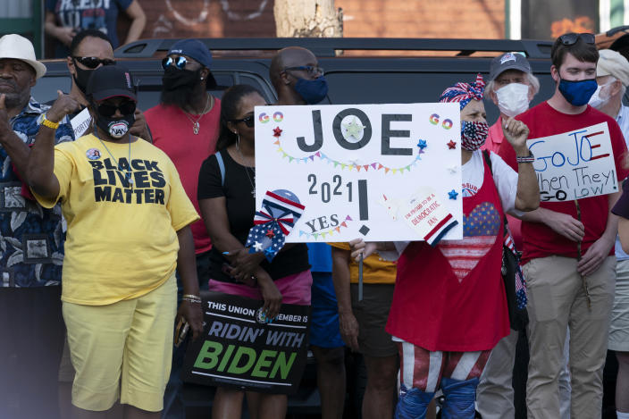 Supporters of Democratic presidential candidate former Vice President Joe Biden wait outside of the AFL-CIO headquarters in Harrisburg, Pa., Monday, Sept. 7, 2020. (AP Photo/Carolyn Kaster)