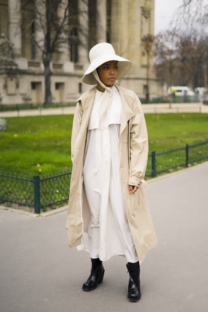 <p>A guest is spotted wearing a super chic trench coat with a matching hat and stompy boots. <em>[Photo: Getty]</em> </p>