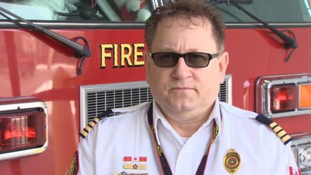 Deputy Chief Chris March wants people to stop burning their lawns and creating the risk of large grass fires that tie up resources.   (Matthew Moore/CBC - image credit)