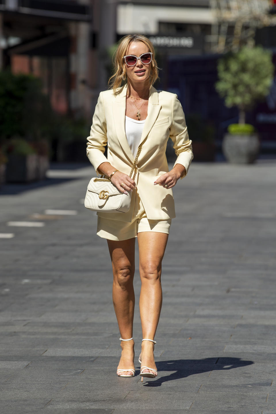 Amanda Holden pictured outside the Global Radio studios on June 14, 2021 in London, England, wearing a yellow short suit from Reiss.  (Getty Images)