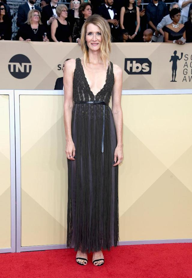 <p>Dern wore a dark sheer dress with a plunging neckline.(Photo: Getty Images) </p>