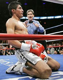 Erik Morales of Mexico suffers the first of two knockdowns in the third round
