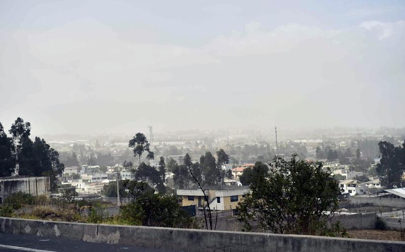 View of a dust cloud on August 12, 2014 in Quito, after a 5.1-magnitude earthquake rattled the Ecuadorian capital and the surrounding area causing buildings and homes to shake violently