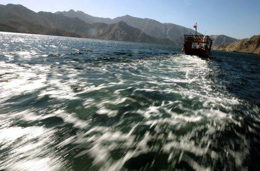 A dhow carrying tourists cruises off the Oman's Khasab shores along the Strait of Hormuz in the Gulf