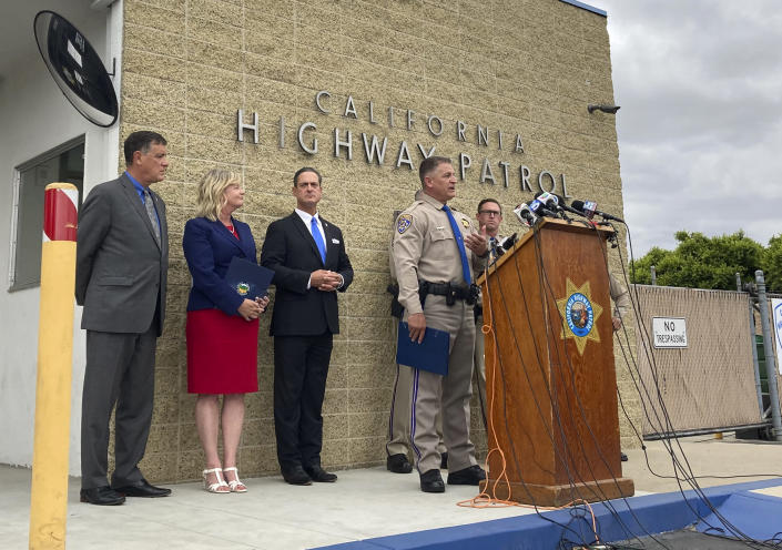 California Highway Patrol Assistant Chief Don Goodbrand talks at the podium during a news conference Monday, June 7, 2021, and is joined by Orange County District Attorney Todd Spitzer third from left and other officials in Costa Mesa, Calif. A man and a woman have been arrested in connection with a road rage shooting that killed a 6-year-old boy last month on a Southern California freeway, authorities said. (AP Photo/Amy Taxin)