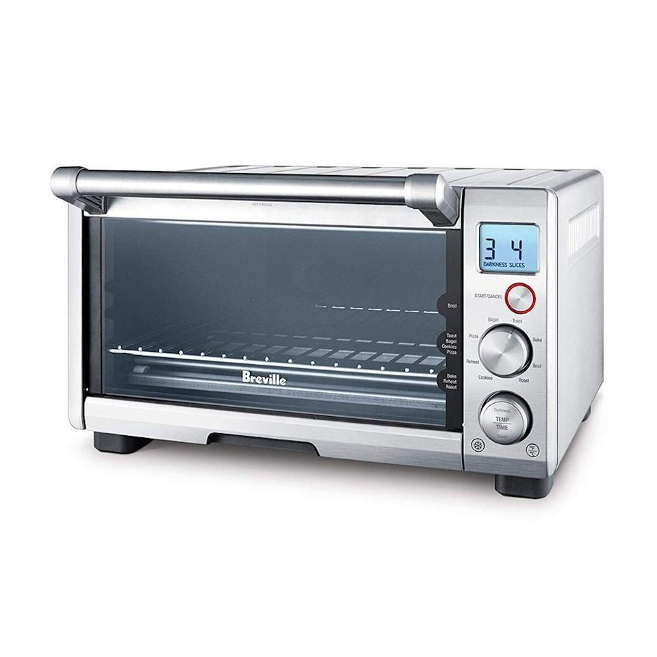 """<p><strong>Breville</strong></p><p>amazon.com</p><p><strong>$274.50</strong></p><p><a href=""""https://www.amazon.com/Breville-BOV800XL-1800-Watt-Convection-Toaster/dp/B001L5TVGW/?tag=syn-yahoo-20&ascsubtag=%5Bartid%7C2089.g.27965170%5Bsrc%7Cyahoo-us"""" rel=""""nofollow noopener"""" target=""""_blank"""" data-ylk=""""slk:Shop Now"""" class=""""link rapid-noclick-resp"""">Shop Now</a></p><p>Toaster ovens are basically the <a href=""""https://www.bestproducts.com/appliances/small/g230/best-toaster-reviews-on-trend/"""" rel=""""nofollow noopener"""" target=""""_blank"""" data-ylk=""""slk:unsung hero of the kitchen"""" class=""""link rapid-noclick-resp"""">unsung hero of the kitchen</a> since they are so versatile and compact. This top-selling Breville Smart Oven is super intuitive with eight easy-to-use cooking functions. <br></p>"""