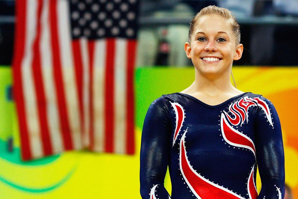 Gold medalist Shawn Johnson of the United States stands on the podium during the medal ceremony for the Women's Beam Final at the National Indoor Stadium on Day 11 of the Beijing 2008 Olympic Games on August 19, 2008 in Beijing, China