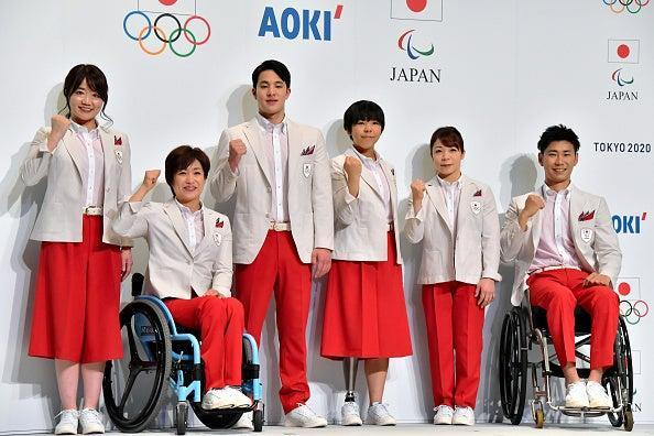 Paralympians and Olympians from the Japan team pose in their delegation uniforms for Tokyo 2020 (The Asahi Shimbun via Getty Imag)