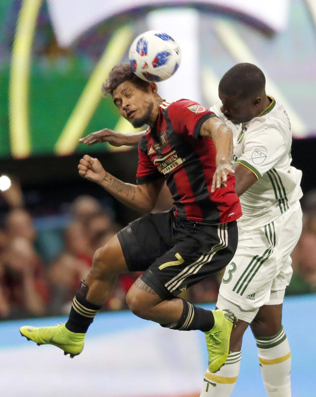 Atlanta United forward Josef Martinez (7) heads the ball against Portland Timbers defender Larrys Mabiala (33) during the first half of the MLS Cup championship soccer game, Saturday, Dec. 8, 2018, in Atlanta. (AP Photo/John Bazemore)