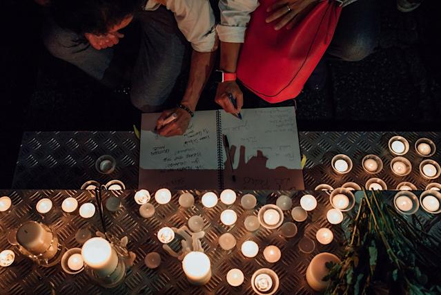 <p>People in Hong Kong take part in a candlelight vigil for the victims of the Orlando massacre, June 13, 2016, in Hong Kong. The vigil was organized by Betty Grisoni, co-director of Pink Dot and co-founder of local lesbian group Les Peches. (Anthony Kwan/Getty Images) </p>