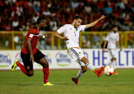 Football Soccer - Trinidad and Tobago v Mexico - World Cup 2018 Qualifiers - Hasely Crawford Stadium, Port of Spain, Trinidad and Tobago - 28/3/17 - Mexico's Diego Reyes and Trinidad and Tobago's Khaleem Hyland (L).  REUTERS/Carlos Garcia Rawlins