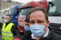 Romanian truckers protest pay cuts in front of the government headquarters in Bucharest