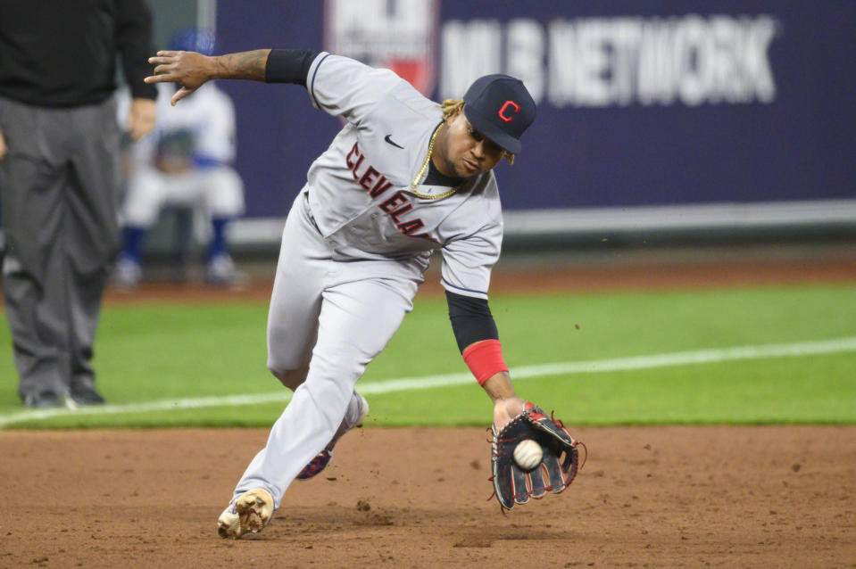 Cleveland Indians third baseman Jose Ramirez scoops up this grounder to throw out Kansas City Royals' Whit Merrifield for the third out in the sixth inning of a baseball game Tuesday, May 4, 2021, in Kansas City, Mo. (AP Photo/Reed Hoffmann)