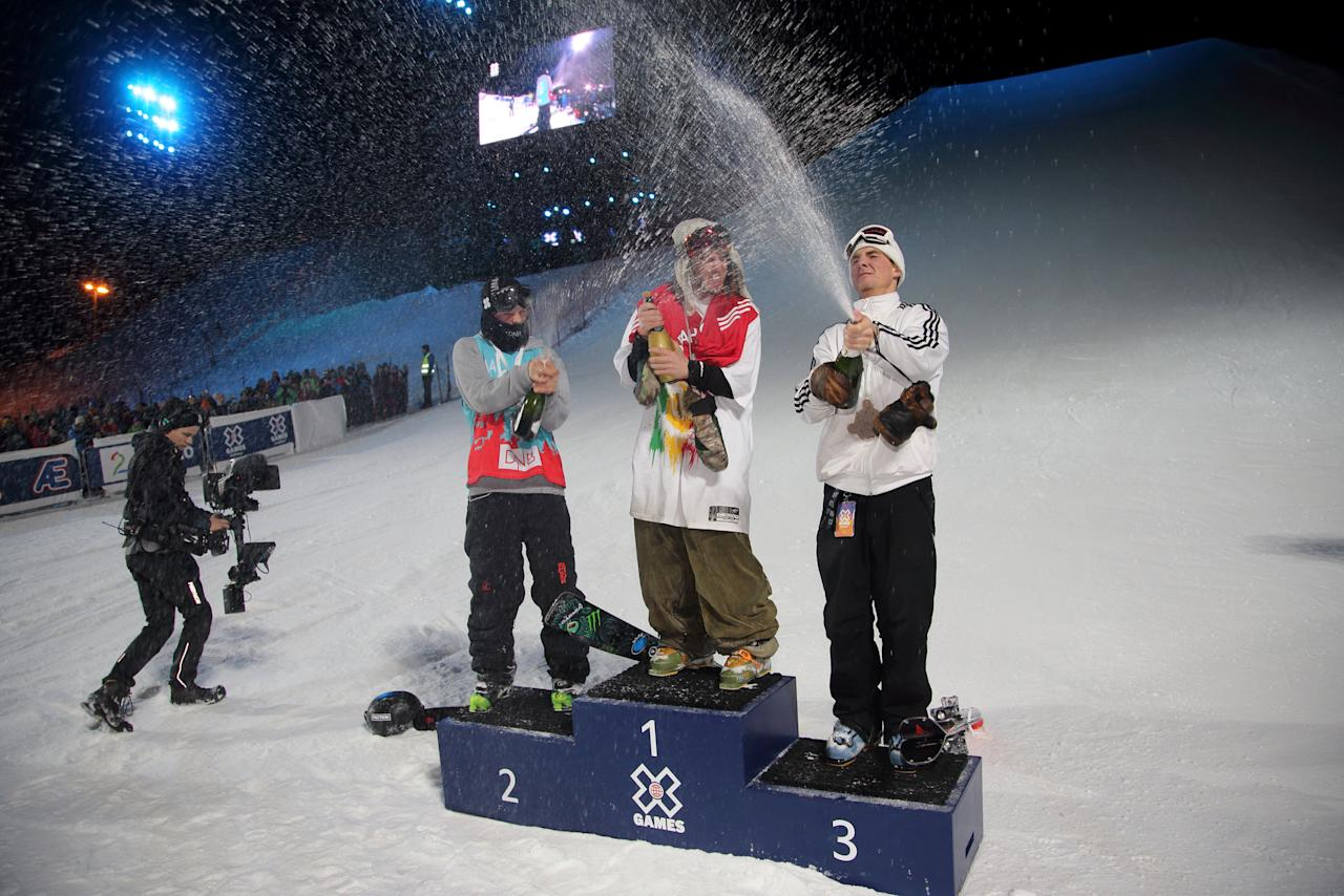 Freestyle Skiing - X Games Men's Big Air Ski finals - Hafjell, Norway - 11/03/17 - Gold medalist Henrik Harlaut from Sweden (center) silver medalist Eirik Saeteroy  from Norway (left) and bronze medalist Jackson Wells from New Zealand. NTB Scanpix/Geir Olsen/via REUTERS ATTENTION EDITORS - THIS IMAGE WAS PROVIDED BY A THIRD PARTY. FOR EDITORIAL USE ONLY. NORWAY OUT. NO COMMERCIAL OR EDITORIAL SALES IN NORWAY. NO COMMERCIAL SALES.