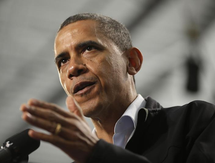 President Barack Obama gestures as he speaks at Springfield High School during a campaign event, Friday, Nov. 2, 2012, in Springfield, Ohio. (AP Photo/Pablo Martinez Monsivais)