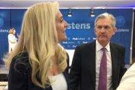 FILE PHOTO: Federal Reserve Chairman Jerome Powell speaks with Fed Governor Lael Brainard at the Federal Reserve Bank of Chicago