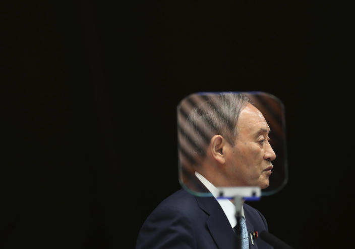 Japanese Prime Minister Yoshihide Suga is seen through a teleprompter as he speaks during his news conference at his office in Tokyo, Thursday, Sept. 9, 2021. Japan announced Thursday it is extending a coronavirus state of emergency in Tokyo and 18 other areas until the end of September as health care systems remain under severe strain, although new infections have slowed slightly. (Kim Kyung-Hoon/Pool Photo via AP)