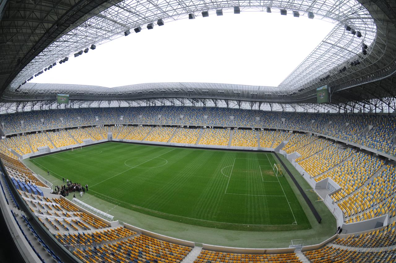 "A general view taken on April 12, 2012 shows the Arena Lviv stadium in the western Ukrainian city of Lviv. UEFA President Michel Platini on April 12 accused ""bandits and crooks"" of hiking hotel prices in Ukraine to sky-high levels for the Euro 2012 football championships, amid growing concerns over the price of accommodation. AFP PHOTO / YURIY DYACHYSHYN (Photo credit should read YURIY DYACHYSHYN/AFP/Getty Images)"