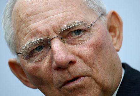 FILE PHOTO: German Finance Minister Wolfgang Schaeuble talks to reporters during the G20 Finance Ministers and Central Bank Governors Meeting in Baden-Baden