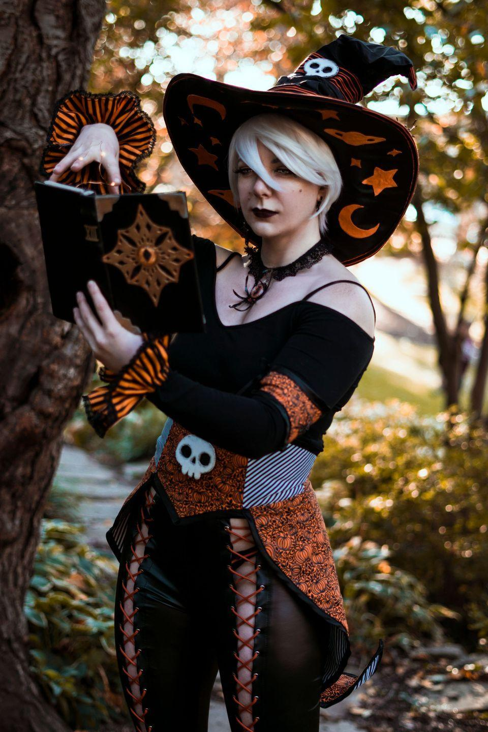 """<p>Looking for a unique spin on the classic witch? Try a fun orange and black take, like this one. If you don't have the sewing know-how to mimic the look, try black lace-up pants, an orange and black blouse, and combat boots. The hat is a bit easier to DIY—use orange tape and an iron-on skeleton patch.</p><p> <a class=""""link rapid-noclick-resp"""" href=""""https://www.amazon.com/Womens-Cutout-Leggings-Bodycon-Bandage/dp/B085TDLGWB?tag=syn-yahoo-20&ascsubtag=%5Bartid%7C10072.g.33534666%5Bsrc%7Cyahoo-us"""" rel=""""nofollow noopener"""" target=""""_blank"""" data-ylk=""""slk:SHOP LACE-UP PANTS"""">SHOP LACE-UP PANTS</a></p><p><a class=""""link rapid-noclick-resp"""" href=""""https://www.amazon.com/Sarin-Mathews-Womens-Casual-T-Shirt/dp/B01HROG9HE/?tag=syn-yahoo-20&ascsubtag=%5Bartid%7C10072.g.33534666%5Bsrc%7Cyahoo-us"""" rel=""""nofollow noopener"""" target=""""_blank"""" data-ylk=""""slk:SHOP ORANGE AND BLACK TOP"""">SHOP ORANGE AND BLACK TOP</a></p><p><a class=""""link rapid-noclick-resp"""" href=""""https://www.amazon.com/Leg-Avenue-Womens-Large-Ruched/dp/B00JSJSTK2?tag=syn-yahoo-20&ascsubtag=%5Bartid%7C10072.g.33534666%5Bsrc%7Cyahoo-us"""" rel=""""nofollow noopener"""" target=""""_blank"""" data-ylk=""""slk:SHOP WITCH HAT"""">SHOP WITCH HAT</a></p><p><a class=""""link rapid-noclick-resp"""" href=""""https://www.amazon.com/Industrial-Waterproof-Resistant-Multiple-Available/dp/B07TD7R7GM?tag=syn-yahoo-20&ascsubtag=%5Bartid%7C10072.g.33534666%5Bsrc%7Cyahoo-us"""" rel=""""nofollow noopener"""" target=""""_blank"""" data-ylk=""""slk:SHOP ORANGE TAPE"""">SHOP ORANGE TAPE</a></p><p><a class=""""link rapid-noclick-resp"""" href=""""https://www.amazon.com/U-Sky-Sew-Iron-Patches-Clothing/dp/B071X72P7T?tag=syn-yahoo-20&ascsubtag=%5Bartid%7C10072.g.33534666%5Bsrc%7Cyahoo-us"""" rel=""""nofollow noopener"""" target=""""_blank"""" data-ylk=""""slk:SHOP SKELETON PATCH"""">SHOP SKELETON PATCH</a></p>"""