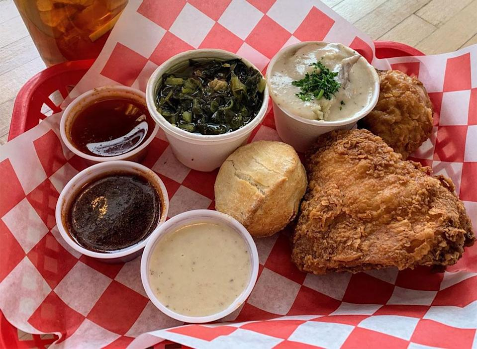 plate of fried chicken with dipping sauces
