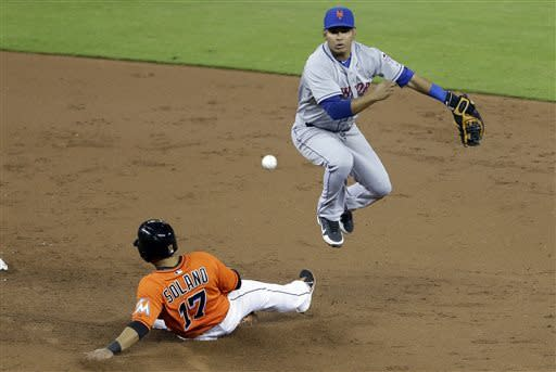 Miami Marlins' Donovan Solano (17) is out at second as New York Mets shortstop Ruben Tejada, right, throws to first to complete a double play in the third inning during a baseball game, Monday, April, 29, 2013 in Miami. (AP Photo/Lynne Sladky)