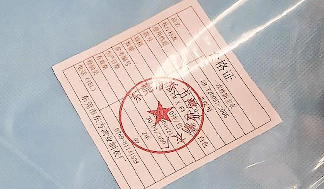 The certificate that comes with the protective clothing states they are 'one-off protective gowns' made in mainland China. Photo: Handout